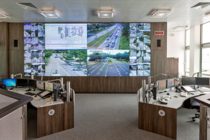 JST - Police Hamburg: Traffic control centre. Large display wall and operator tables