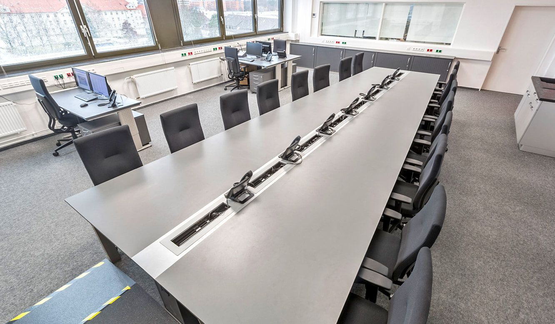 JST - Autorisierte Stelle Digitalfunk Niedersachsen: Storage room with AllMedia conference table