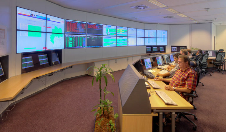 GAD - IT control centre of JST - Staff in front of the large display wall