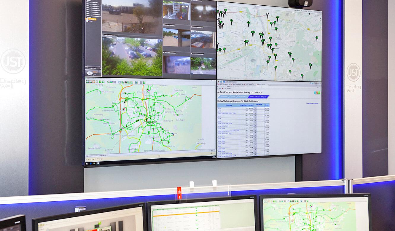 JST - Göttinger Verkehrsbetriebe: Monitorwand mit vier Business-Displays
