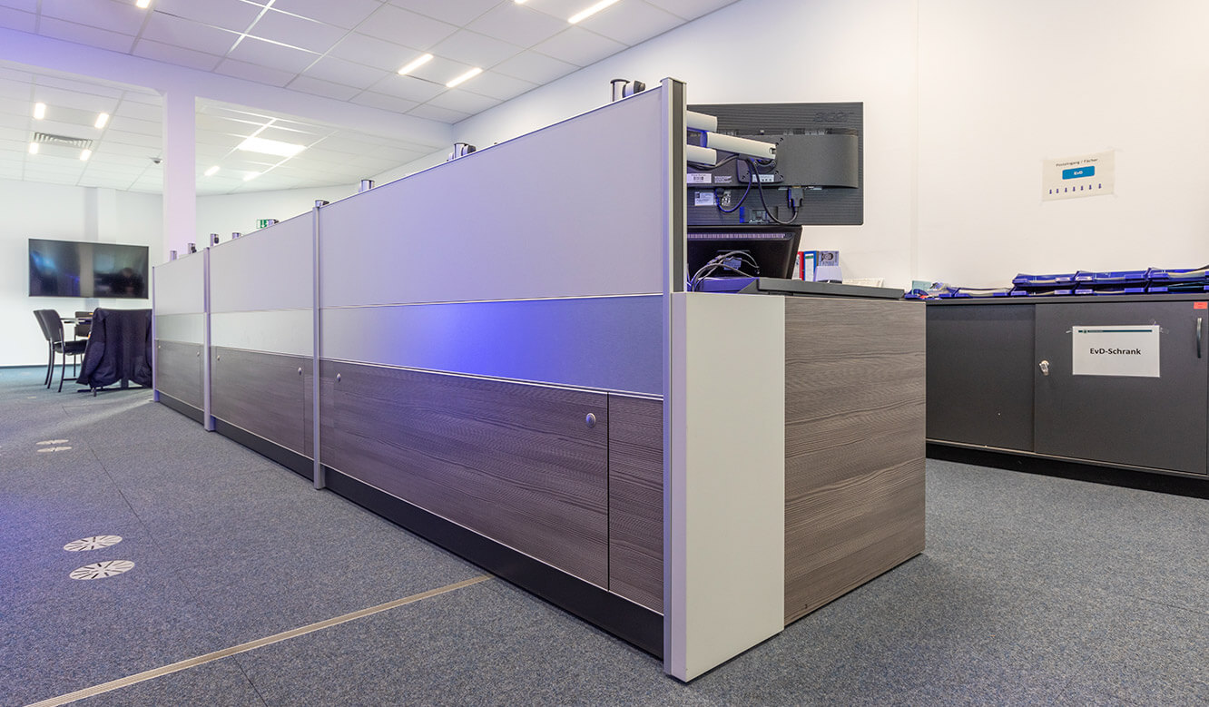 JST reference Bremen Police Video control centre: Table for control centre with technology storage room and ergonomic concept