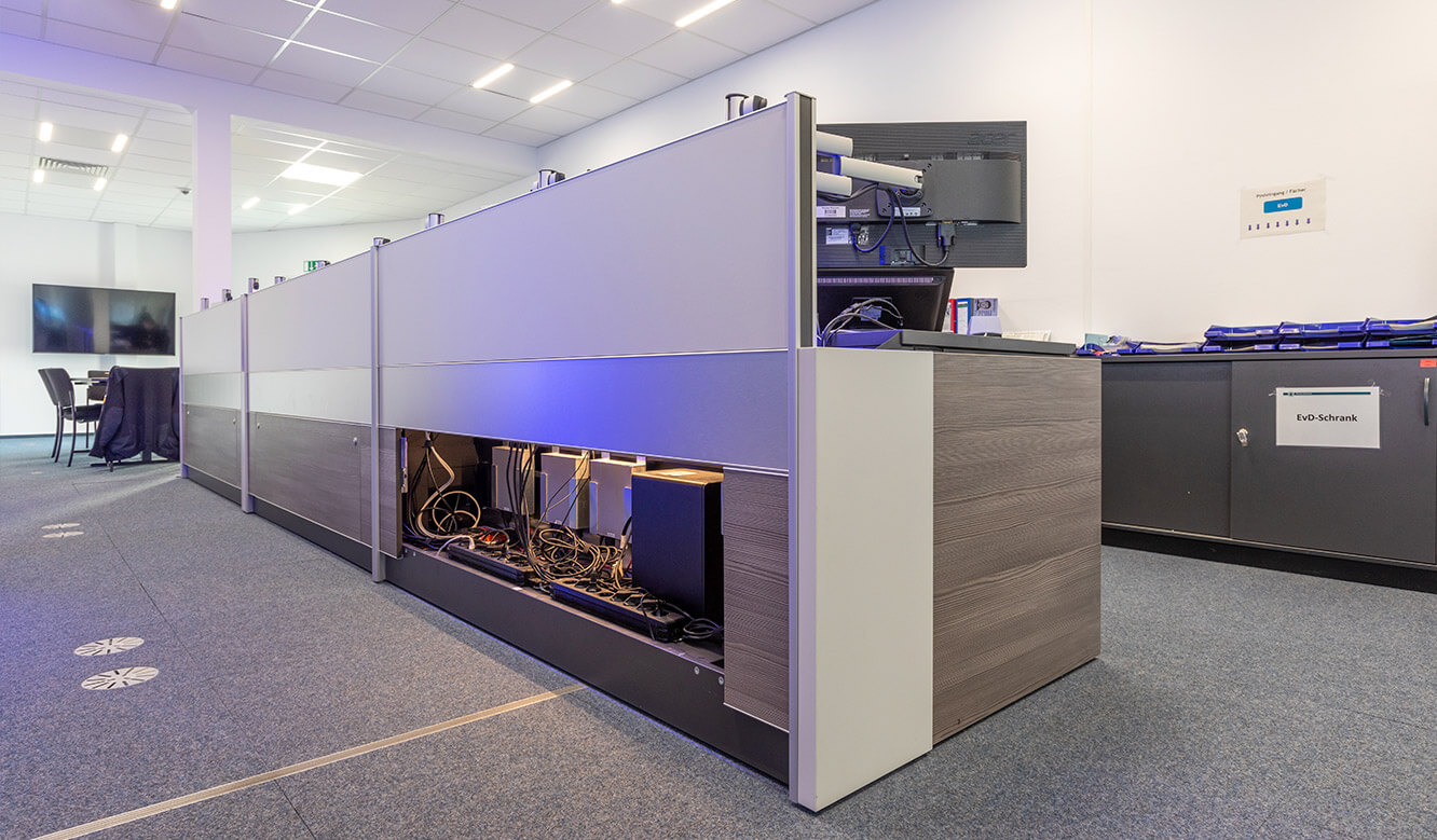 JST reference Bremen Police Video control centre: Table for control room with space for technology and ergonomic solution