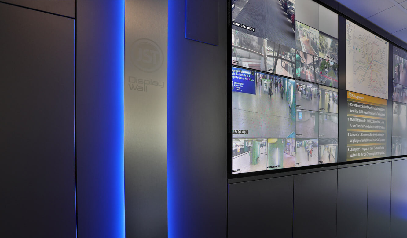 JST Referenz protec service GmbH - modern IT solution emergency control center - video wall with large screen displays and lighting for alarm detection